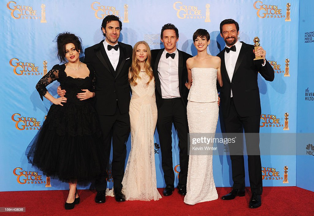 Actors Helena Bonham Carter, Sacha Baron Cohen, Amanda Seyfried, Eddie Redmayne, Anne Hathaway and Hugh Jackman of 'Les Miserables' pose in the press room during the 70th Annual Golden Globe Awards held at The Beverly Hilton Hotel on January 13, 2013 in Beverly Hills, California.