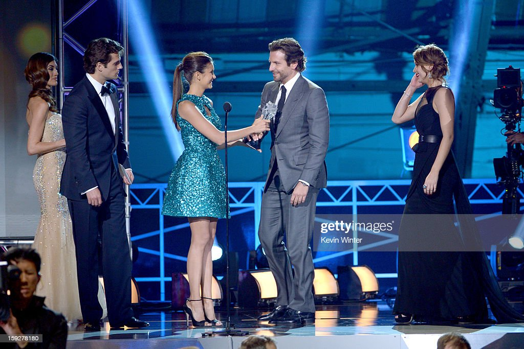 Actors Henry Cavill and Nina Dobrev present actors Bradley Cooper and Jennifer Lawrence the Best Acting Ensemble Award for 'Silver Linings Playbook' onstage at the 18th Annual Critics' Choice Movie Awards held at Barker Hangar on January 10, 2013 in Santa Monica, California.