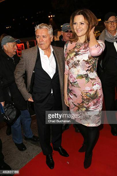 Actors Henry Hubchen and Martina Gedeck attend the 'Am Hang' German Premiere at Kino International on November 20 2013 in Berlin Germany