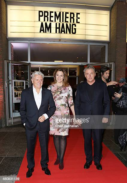 Actors Henry Hubchen Martina Gedeck and director Markus Imboden attend the 'Am Hang' German Premiere at Kino International on November 20 2013 in...
