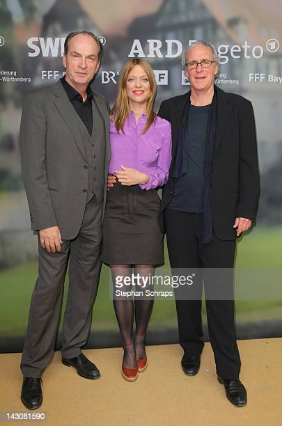 Actors Herbert Knaup Heike Makatsch and August Zirner attend the premiere of 'Die Heimkehr' at Astor Film Lounge movie theater Kurfuerstendamm on...