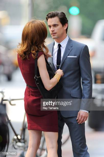 Actors Hilarie Burton and Matt Bomer film a scene on the 'White Collar' film set in Midtown Manhattan on June 8 2011 in New York City