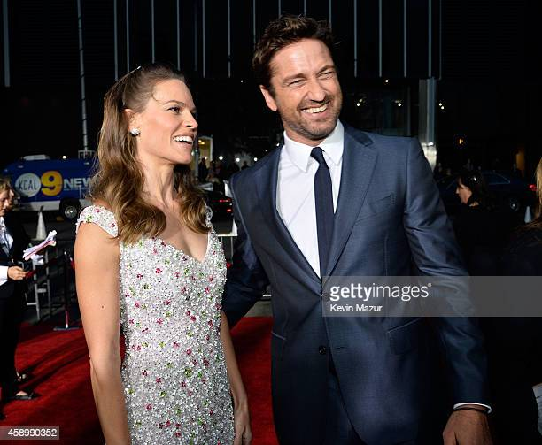 Actors Hilary Swank and Gerard Butler attend the 18th Annual Hollywood Film Awards at The Palladium on November 14 2014 in Hollywood California
