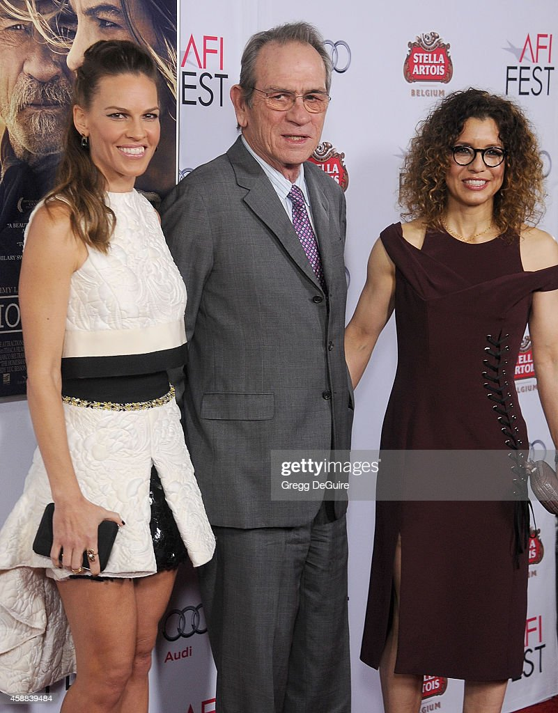 Actors Hilary Swank Tommy Lee Jones and wife Dawn Laurel Jones arrive at the AFI FEST 2014 Presented By Audi 'The Homesman' Premiere at Dolby Theatre...