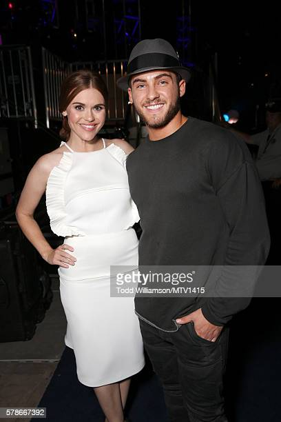 Actors Holland Roden and Cody Christian pose backstage the MTV Fandom Awards San Diego at PETCO Park on July 21 2016 in San Diego California