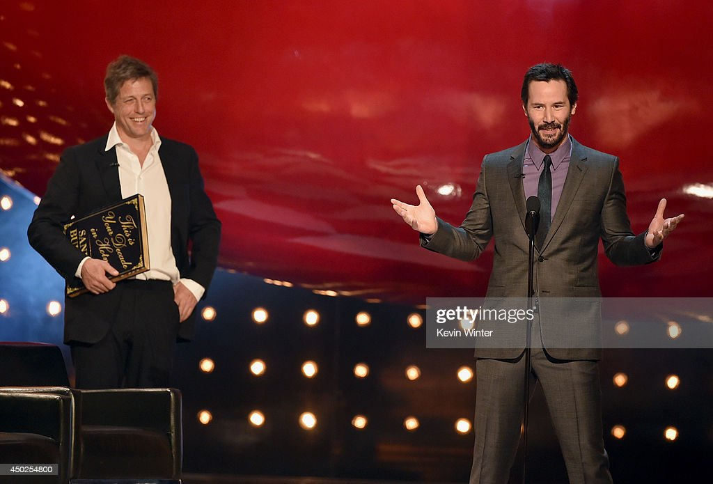 Actors Hugh Grant (L) and Keanu Reeves speak onstage during Spike TV's 'Guys Choice 2014' at Sony Pictures Studios on June 7, 2014 in Culver City, California.