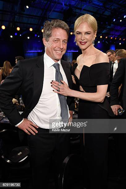 Actors Hugh Grant and Nicole Kidman attend The 22nd Annual Critics' Choice Awards at Barker Hangar on December 11 2016 in Santa Monica California