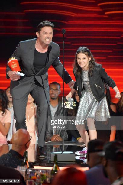 Actors Hugh Jackman and Dafne Keen appear onstage during the 2017 MTV Movie And TV Awards at The Shrine Auditorium on May 7 2017 in Los Angeles...