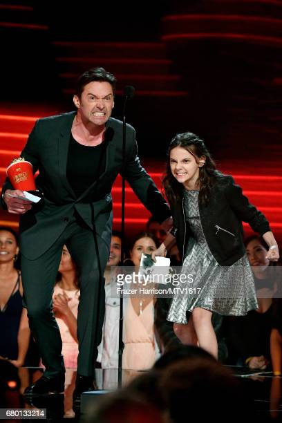 Actors Hugh Jackman and Dafne Keen winners of Best Duo for 'Logan' accept award onstage during the 2017 MTV Movie And TV Awards at The Shrine...
