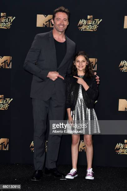 Actors Hugh Jackman and Dafne Keen winners of Best Duo for 'Logan' pose in the press room during the 2017 MTV Movie And TV Awards at The Shrine...