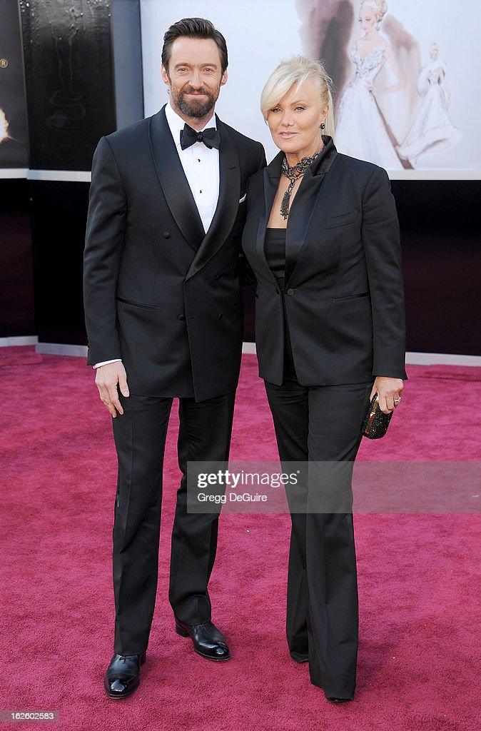 Actors Hugh Jackman and wife Deborra-Lee Furness arrive at the Oscars at Hollywood & Highland Center on February 24, 2013 in Hollywood, California.