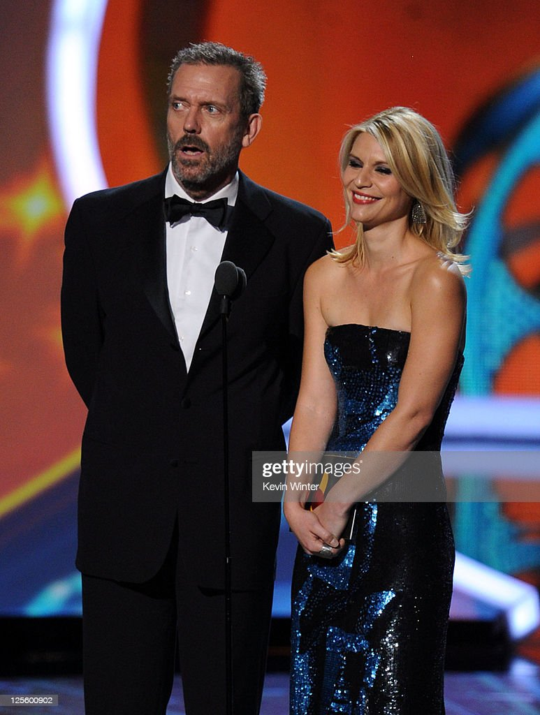 Actors <a gi-track='captionPersonalityLinkClicked' href=/galleries/search?phrase=Hugh+Laurie&family=editorial&specificpeople=217383 ng-click='$event.stopPropagation()'>Hugh Laurie</a> (L) and <a gi-track='captionPersonalityLinkClicked' href=/galleries/search?phrase=Claire+Danes&family=editorial&specificpeople=202666 ng-click='$event.stopPropagation()'>Claire Danes</a> speak onstage during the 63rd Annual Primetime Emmy Awards held at Nokia Theatre L.A. LIVE on September 18, 2011 in Los Angeles, California.