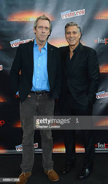 Actors Hugh Laurie and George Clooney attend Walt Disney Studios' 2014 New York Comic Con presentations of 'Big Hero 6' and 'Tomorrowland' at the...