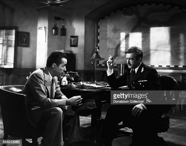 Actors Humphrey Bogart and Claude Rains pose for a publicity still for the Warner Bros film 'Casablanca' in 1942 in Los Angeles California