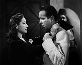 Actors Humphrey Bogart and Joy Page pose for a publicity still for the Warner Bros film 'Casablanca' in 1942 in Los Angeles California