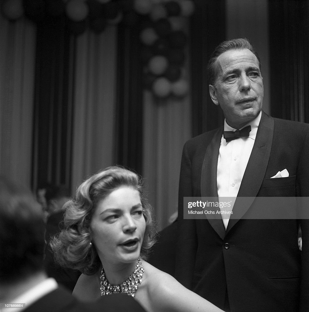 Actors Humphrey Bogart and Lauren Bacall attend the Academy Awards on March 30, 1955 in Los Angeles, California.