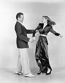 Actors Humphrey Bogart and Lauren Bacall pose for a publicity still for the Warner Bros film 'To Have and Have Not' in 1944 in Los Angeles California