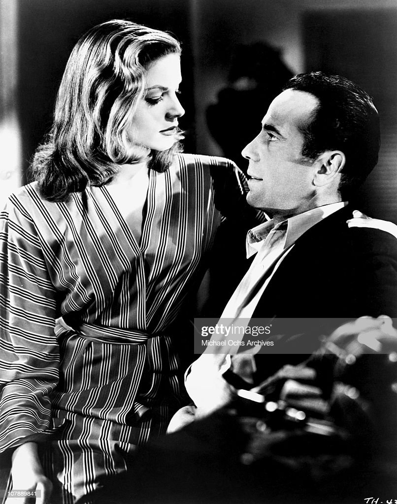Actors Humphrey Bogart and Lauren Bacall pose for a studio publicity Still to promote their movie 'To Have And Have Not' in 1944 in Los Angeles...