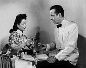 Actors Humphrey Bogart and Melie Chang pose for a publicity still for the Warner Bros film 'Casablanca' in 1942 in Los Angeles California