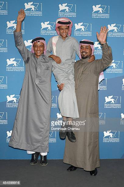 Actors Hussein Salameh Jacir Eid and Hassan Mutlag attend the 'Theeb' photocall during the 71st Venice Film Festival at Palazzo del Cinema on...