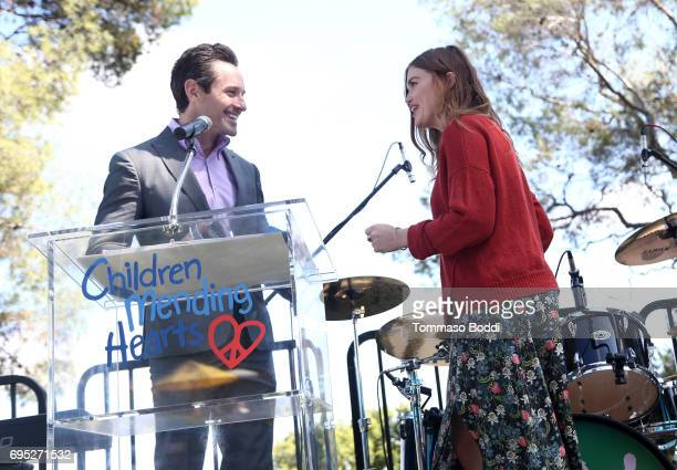 Actors Ian Bohen and Holland Roland speak onstage at Children Mending Hearts' 9th Annual Empathy Rocks on June 11 2017 in Bel Air California