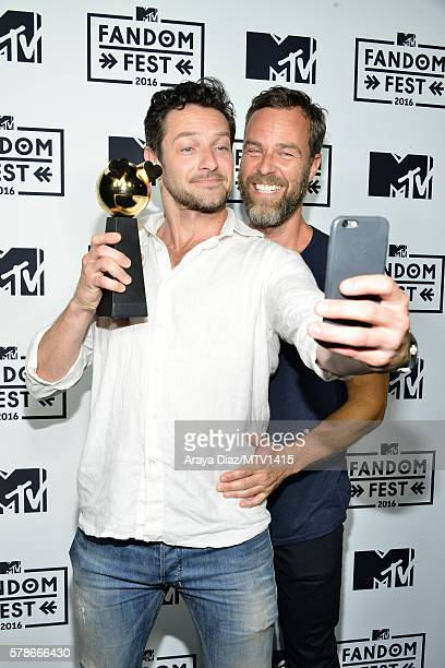 ` Actors Ian Bohen and JR Bourne pose with Fandom of the Year award backstage at the MTV Fandom Awards San Diego at PETCO Park on July 21 2016 in San...