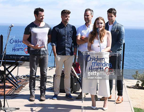 Actors Ian Bohen Charlie Carver JR Bourne Holland Roden and Max Carver receive an award at Children Mending Hearts 7th Annual Fundraiser Presented By...