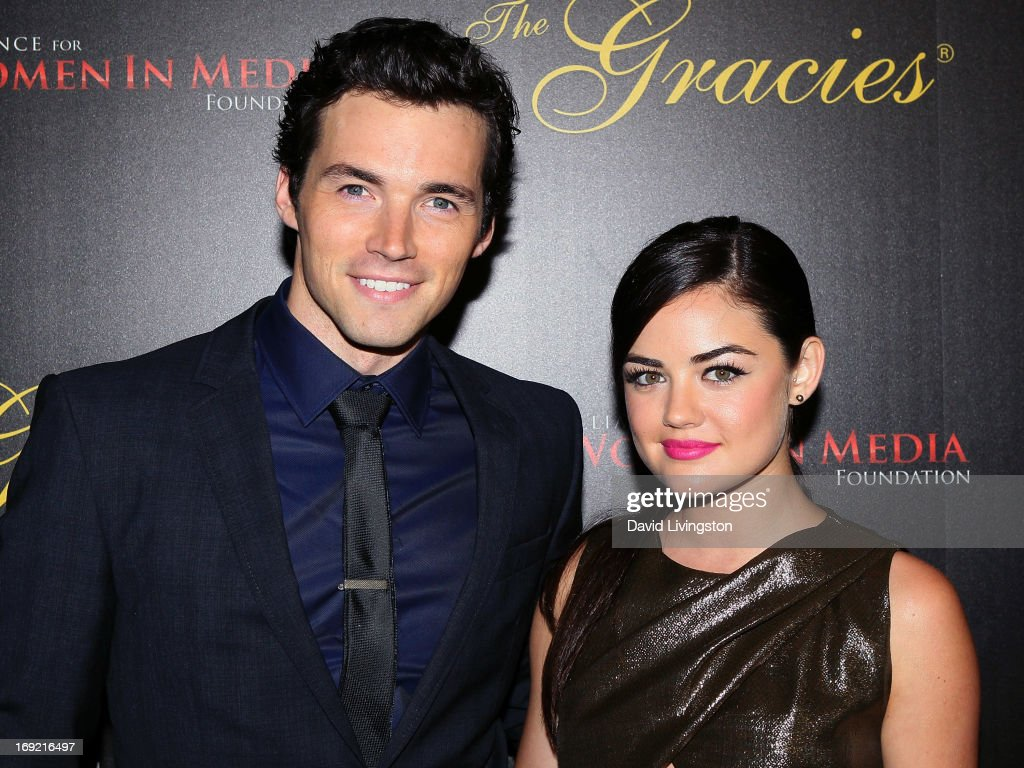 Actors <a gi-track='captionPersonalityLinkClicked' href=/galleries/search?phrase=Ian+Harding&family=editorial&specificpeople=7133462 ng-click='$event.stopPropagation()'>Ian Harding</a> (L) and <a gi-track='captionPersonalityLinkClicked' href=/galleries/search?phrase=Lucy+Hale&family=editorial&specificpeople=4430849 ng-click='$event.stopPropagation()'>Lucy Hale</a> attend the 38th Annual Gracie Awards Gala at The Beverly Hilton Hotel on May 21, 2013 in Beverly Hills, California.