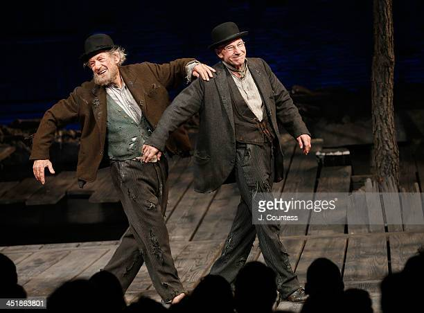 Actors Ian McKellen and Patrick Stewart perform a dance during curtain call at the opening night of 'Waiting For Godot' at the Cort Theatre on...