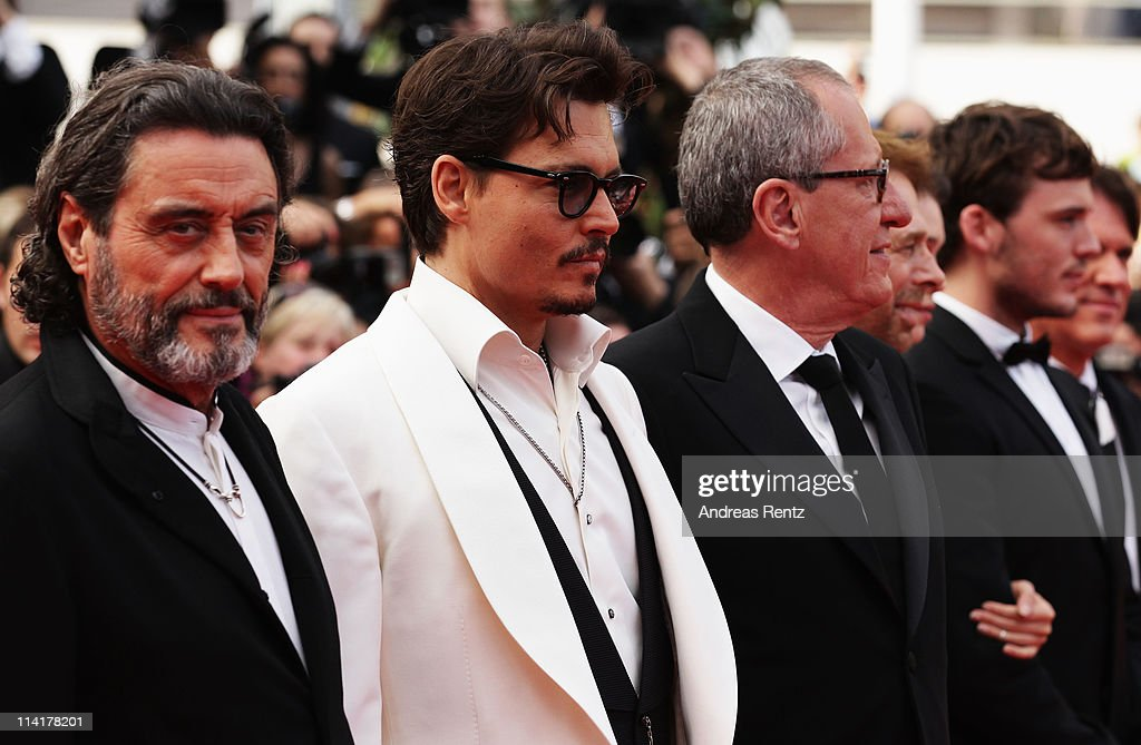 Actors Ian McShane,<a gi-track='captionPersonalityLinkClicked' href=/galleries/search?phrase=Johnny+Depp&family=editorial&specificpeople=202150 ng-click='$event.stopPropagation()'>Johnny Depp</a> and Geoffrey Rush On Stranger Tides' premiere at the Palais des Festivals during the 64th Cannes Film Festival on May 14, 2011 in Cannes, France.