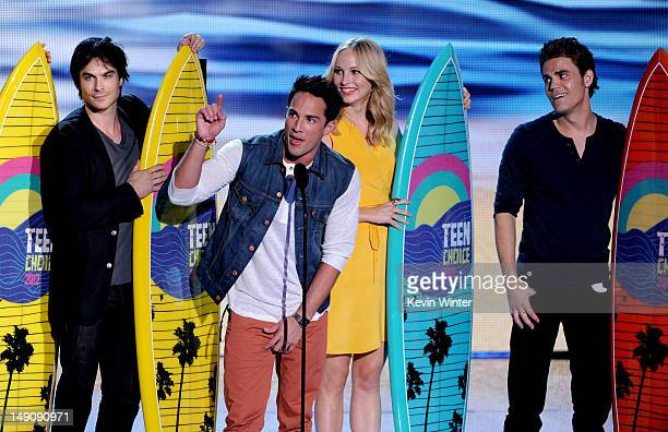 Actors Ian Somerhalder Michael Trevino Candice Accola and Paul Wesley accept the Choice Fantasy/SciFi Show award onstage during the 2012 Teen Choice...