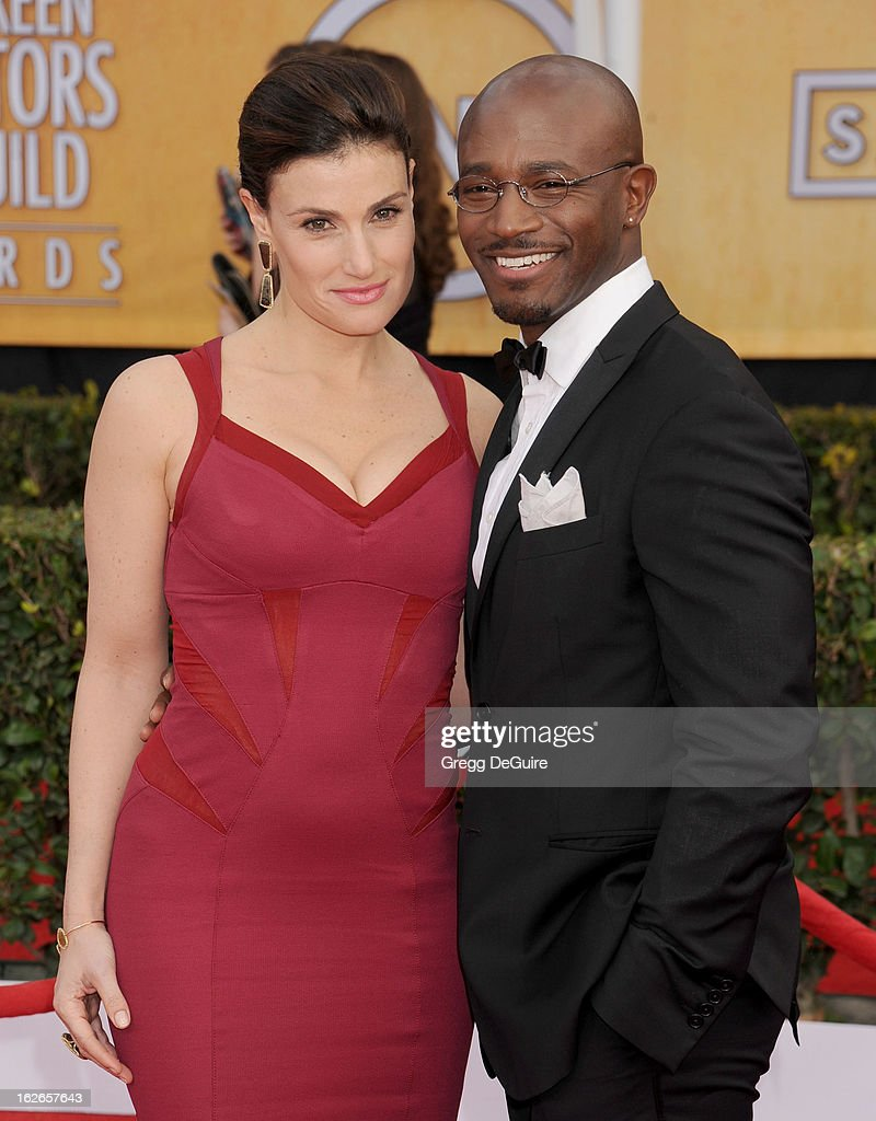 Actors Idina Menzel and Taye Diggs arrive at the 19th Annual Screen Actors Guild Awards at The Shrine Auditorium on January 27, 2013 in Los Angeles, California.