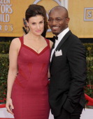 Actors Idina Menzel and Taye Diggs arrive at the 19th Annual Screen Actors Guild Awards at The Shrine Auditorium on January 27 2013 in Los Angeles...