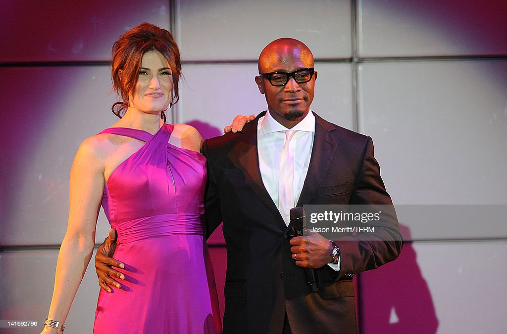 Actors Idina Menzel and Taye Diggs perform at the 20th Anniversary Alzheimer's Association 'A Night at Sardi's' at The Beverly Hilton Hotel on March...
