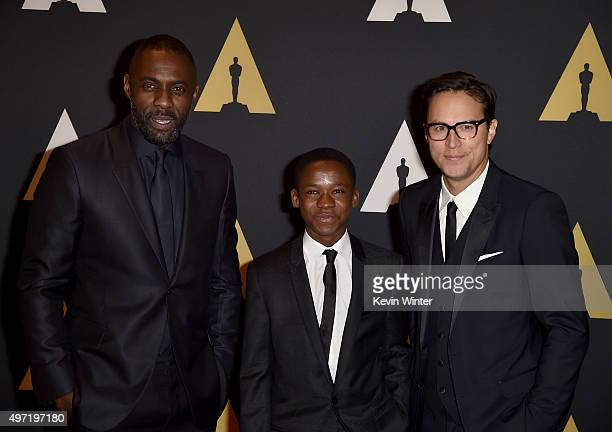 Actors Idris Elba Abraham Attah and director Cary Joji Fukunaga attend the Academy of Motion Picture Arts and Sciences' 7th annual Governors Awards...