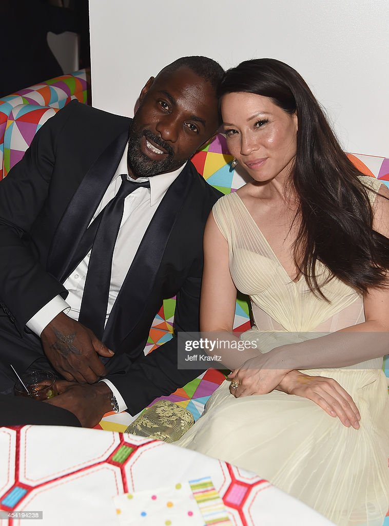 Actors Idris Elba and Lucy Liu attend HBO's Official 2014 Emmy After Party at The Plaza at the Pacific Design Center on August 25 2014 in Los Angeles...