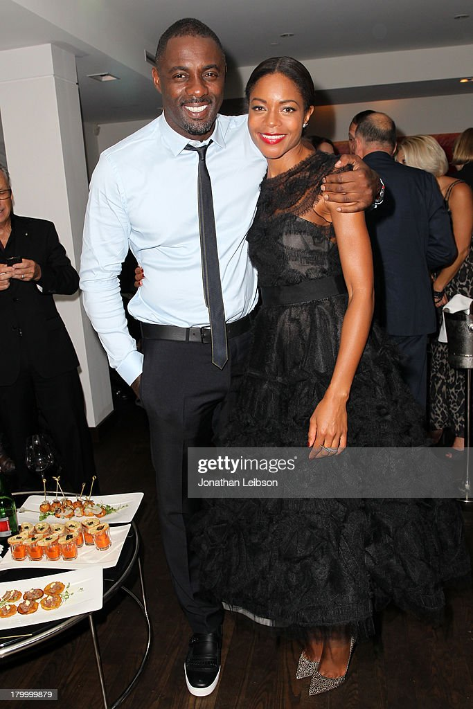 Actors <a gi-track='captionPersonalityLinkClicked' href=/galleries/search?phrase=Idris+Elba&family=editorial&specificpeople=215443 ng-click='$event.stopPropagation()'>Idris Elba</a> and Naomie Harris attend the Burberry supported premiere and celebration of 'Mandela: Long Walk to Freedom' hosted by The Weinstein Company and Entertainment One at the Toronto International Film Festival on September 7, 2013 in Toronto, Canada.