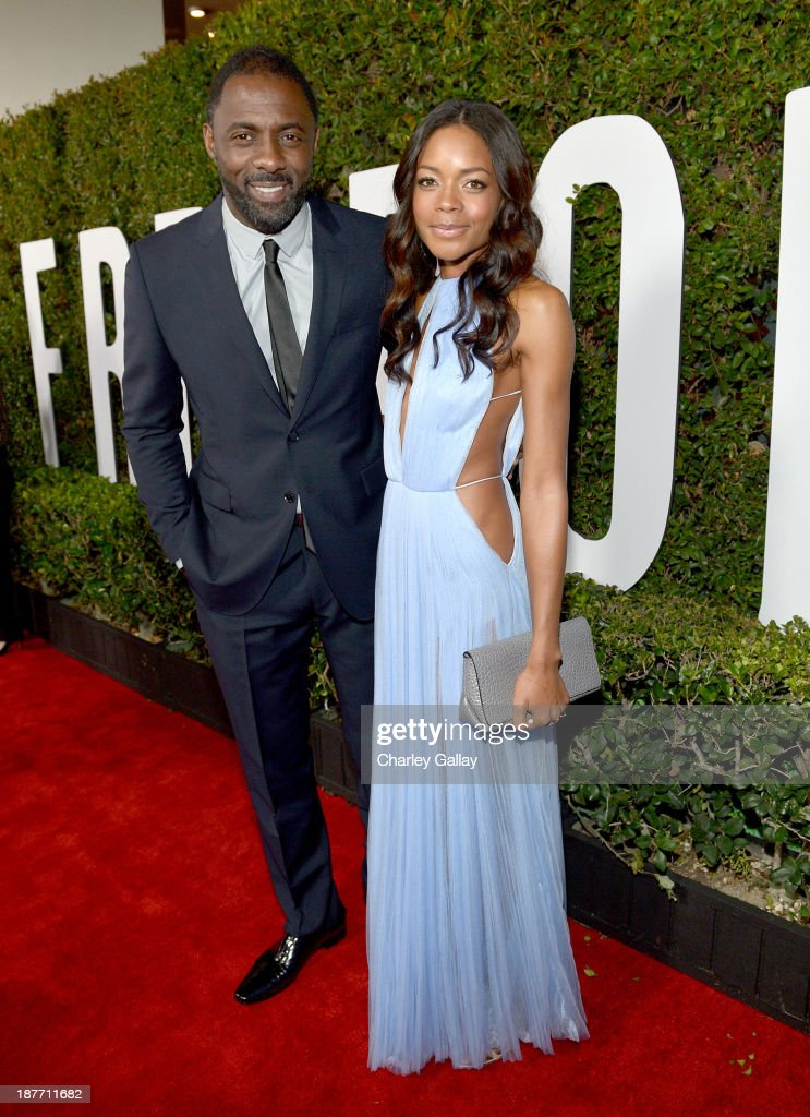 Actors <a gi-track='captionPersonalityLinkClicked' href=/galleries/search?phrase=Idris+Elba&family=editorial&specificpeople=215443 ng-click='$event.stopPropagation()'>Idris Elba</a> (L) and <a gi-track='captionPersonalityLinkClicked' href=/galleries/search?phrase=Naomie+Harris&family=editorial&specificpeople=238918 ng-click='$event.stopPropagation()'>Naomie Harris</a> attend 'The Weinstein Company Presents The LA Premiere Of 'Mandela: Long Walk To Freedom' Supported By Burberry' at ArcLight Hollywood Cinerama Dome on November 11, 2013 in Los Angeles, California.