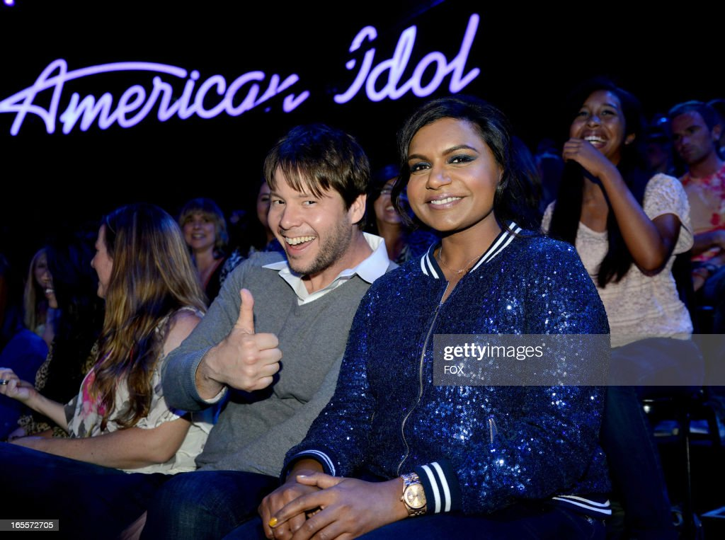 Actors Ike Barinholtz (L) and Mindy Kaling in the audience at FOX's 'American Idol' Season 12 Top 7 to 6 Live Elimination Show on April 4, 2013 in Hollywood, California.