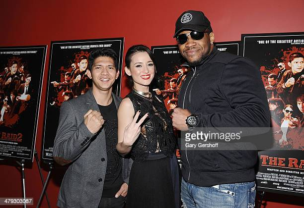 Actors Iko Uwais and Julie Estelle and professional boxer Jarrell 'Big Baby' Miller attend 'The Raid 2' special screening at Sunshine Landmark on...
