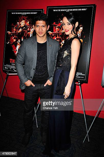 Actors Iko Uwais and Julie Estelleattends 'The Raid 2' special screening at Sunshine Landmark on March 17 2014 in New York City