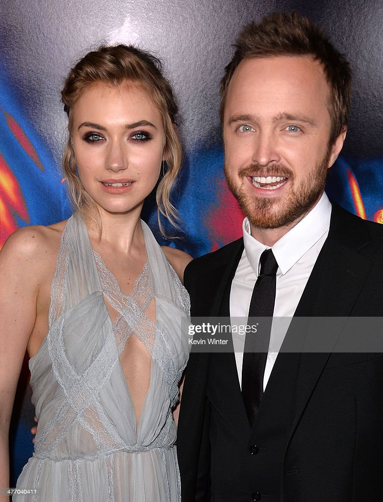 Actors Imogen Poots (L) and Aaron Paul arrive at the premiere of DreamWorks Pictures' 'Need For Speed' at TCL Chinese Theatre on March 6, 2014 in Hollywood, California.
