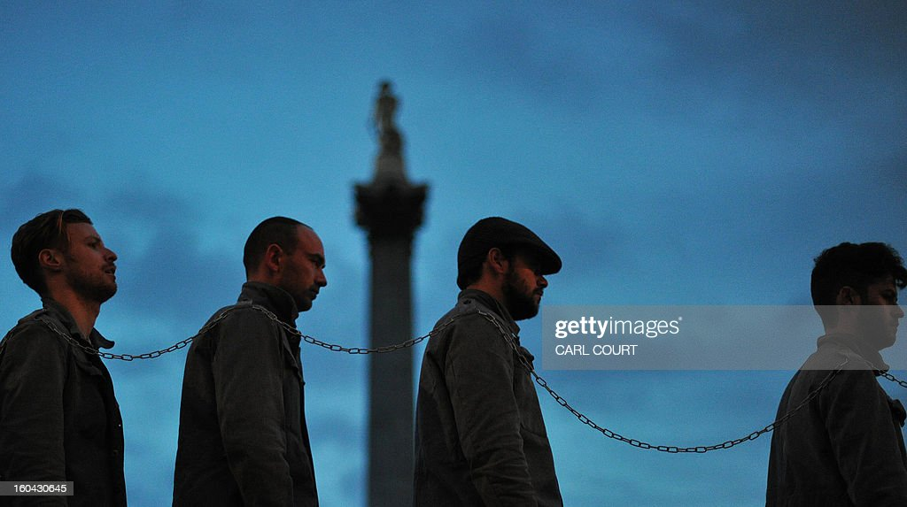 Actors in old fashioned US prison outfits take part in a photocall in Trafalgar Square in central London on January 31, 2013 to mark the extra dates added to Future Cinema's run of The Shawshank Redemption.