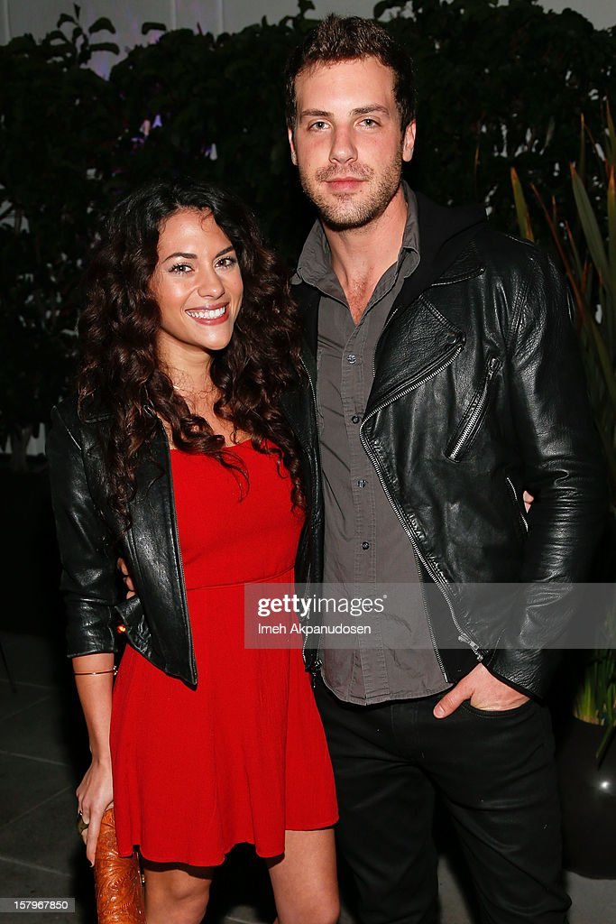 Actors Inbar Lavi (L) and Tilky Jones attend the Celebration of NYLON's December/January Cover Star Lucy Hale Presented by bebe at Andaz Hotel on December 7, 2012 in Los Angeles, California.