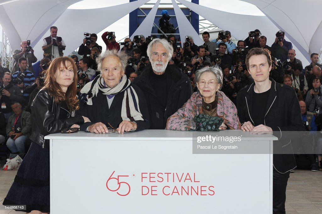 Actors <a gi-track='captionPersonalityLinkClicked' href=/galleries/search?phrase=Isabelle+Huppert&family=editorial&specificpeople=662796 ng-click='$event.stopPropagation()'>Isabelle Huppert</a>, <a gi-track='captionPersonalityLinkClicked' href=/galleries/search?phrase=Jean-Louis+Trintignant&family=editorial&specificpeople=1822183 ng-click='$event.stopPropagation()'>Jean-Louis Trintignant</a>, director Michael Haneke, <a gi-track='captionPersonalityLinkClicked' href=/galleries/search?phrase=Emmanuelle+Riva&family=editorial&specificpeople=2029319 ng-click='$event.stopPropagation()'>Emmanuelle Riva</a> and Alexandre Tharaud pose at the 'Amour' Photocall during the 65th Annual Cannes Film Festival at Palais des Festivals on May 20, 2012 in Cannes, France.