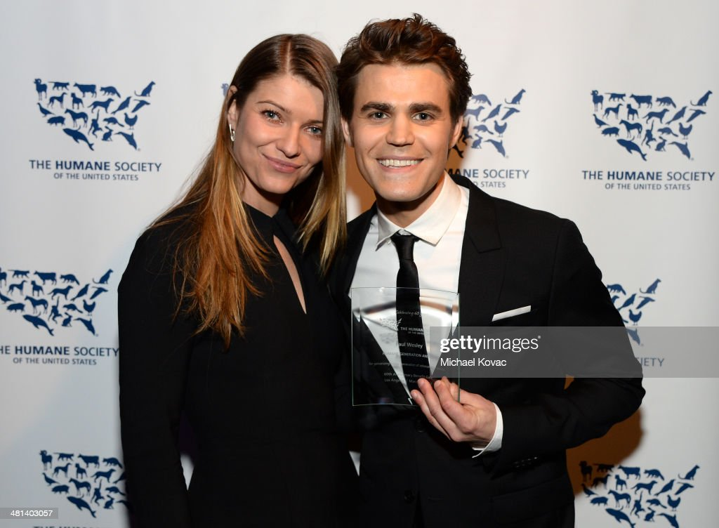 Actors Ivana Milicevic (L) and honoree Paul Wesley attend the Humane Society of The United States 60th Anniversary Gala at The Beverly Hilton Hotel on March 29, 2014 in Beverly Hills, California.