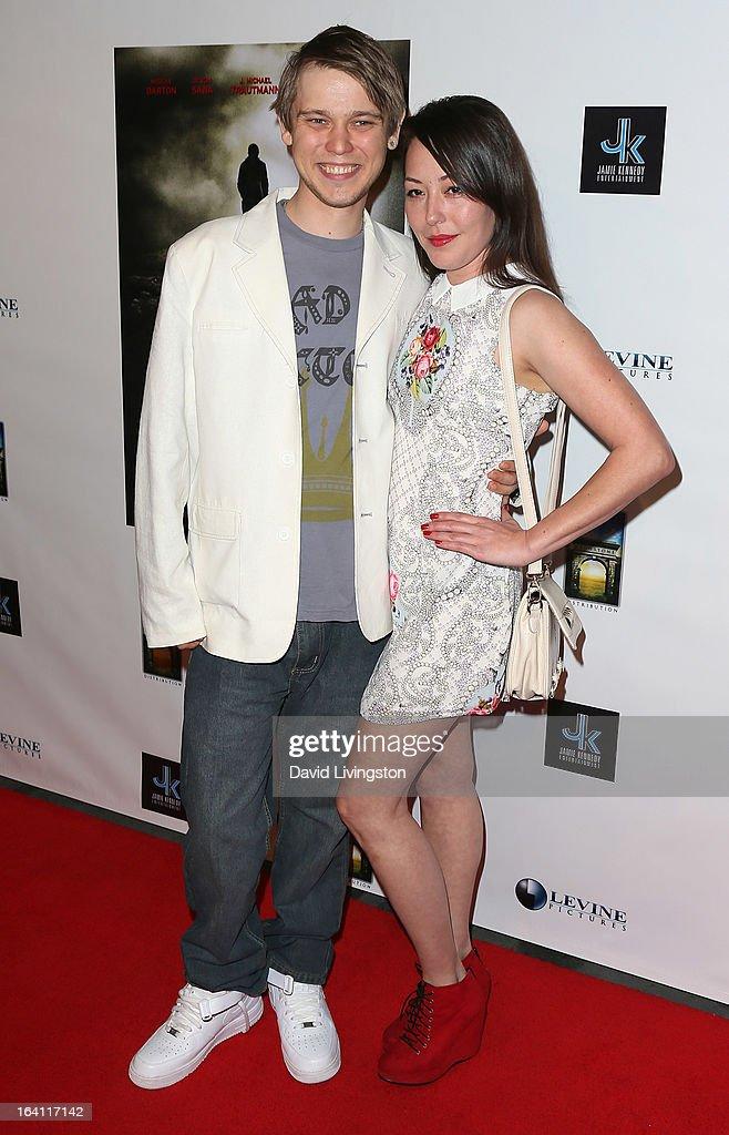 Actors J. Michael Trautmann (L) and Alyssa Lobit attend the premiere of 'A Resurrection' at ArcLight Sherman Oaks on March 19, 2013 in Sherman Oaks, California.