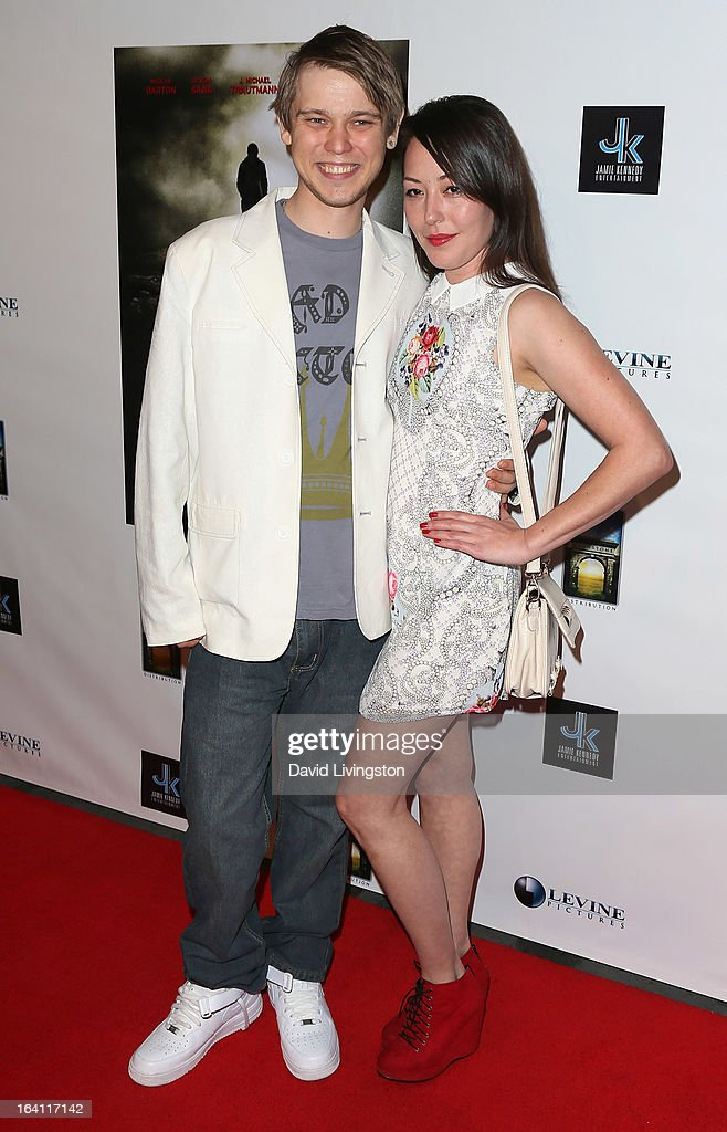 Actors J. Michael Trautmann (L) and Alyssa Lobit attend the premiere of 'A Resurrection' at ArcLight Sherman Oaks on March 19, 2013 in Sherman Oaks, California.
