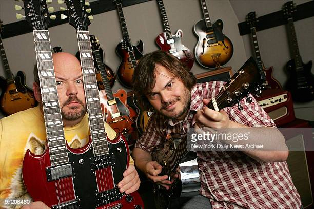 Actors Jack Black and Kyle Gass check out the merchandise during a visit to the Gibson Guitar showroom on W 54th St They play rock stars in the...