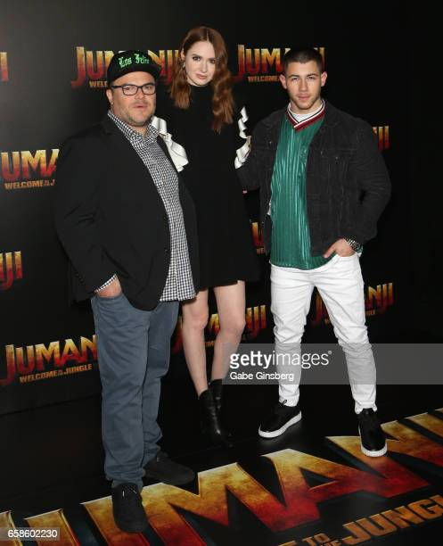 Actors Jack Black Karen Gillan and actor/singer Nick Jonas attend a photo call for Columbia Pictures' 'Jumanji Welcome to the Jungle' during...
